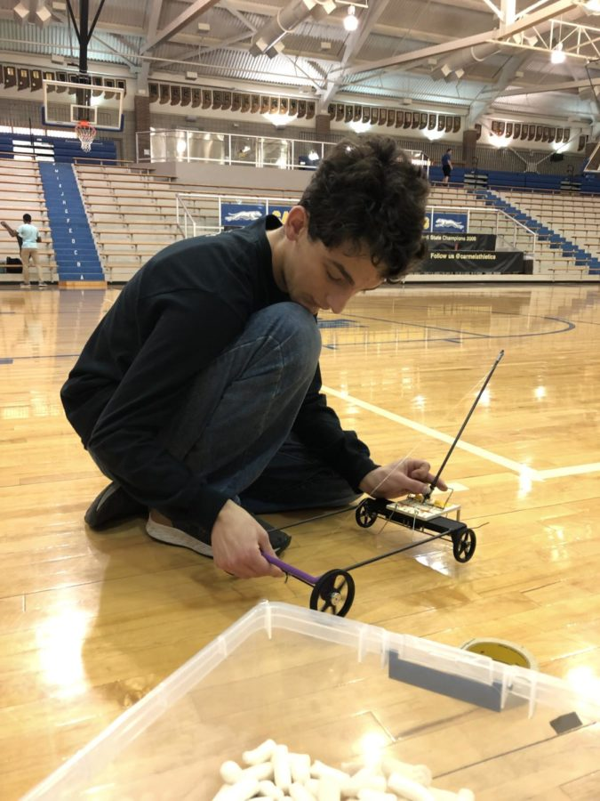 Competition Prep: Junior Yannik Singh works on a vehicle during SRT on March 14. Singh, along with others, are preparing for the Science Olympiad state competition on March 16.