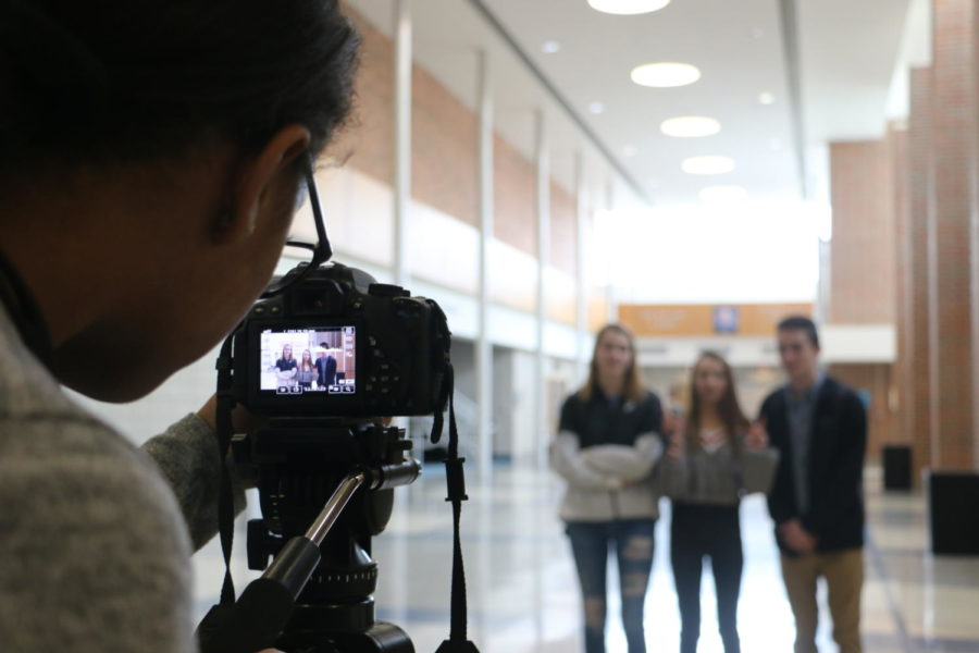 Impromptu Interviews: CHTV reporter and junior Cameron Beteet records an interview for CHTV during SRT in the commons. Beteet moved the camera back and adjusted the settings to fit the interviewer and senior Ayanna Newhouse, interviewee and junior Emme Walschlager and interviewee and senior Charlie Hunter.