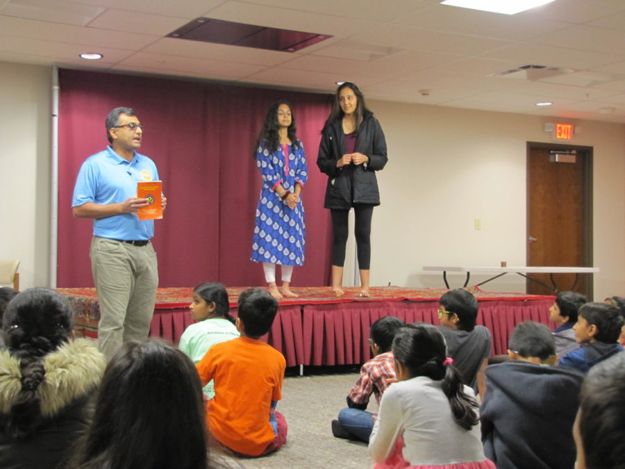 Chetnana members Sophomore Rishma Chauhan and Junior Shreya Bothra present to Balagokulum students. They reviewed their experiences volunteering at the Gleaner's Food Bank as a group bonding event.