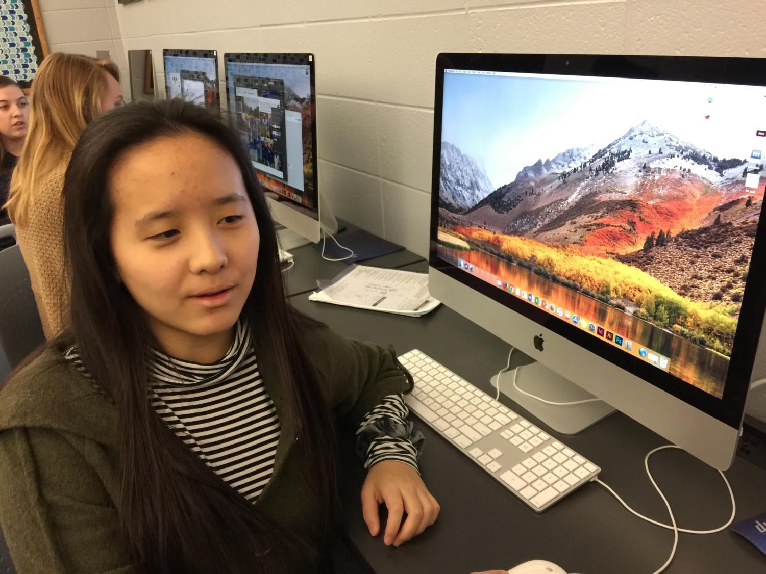 """Hannah Liu, Pinnacle reporter and junior, discusses with her peers about the many articles and photos they have to submit for the major deadline next month. """"We also have to take club photos this month during SRT along with the deadlines, so it's pretty stressful,"""