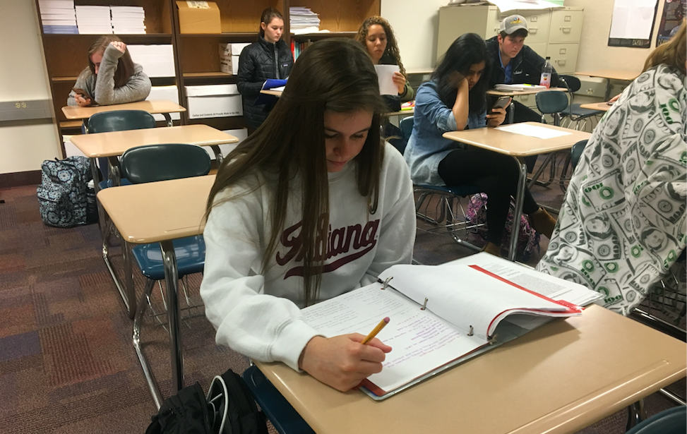 Mentor and senior Caroline Crediford studies during SRT before going out to meet her mentees during third period. According to K-8 Mentoring teacher Robin Pletcher, the mentors met their kids for the first time last week.