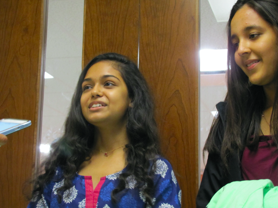 Sophomore Rishma Chauhan talks to visitors at the temple. She discussed recent and future volunteering events.