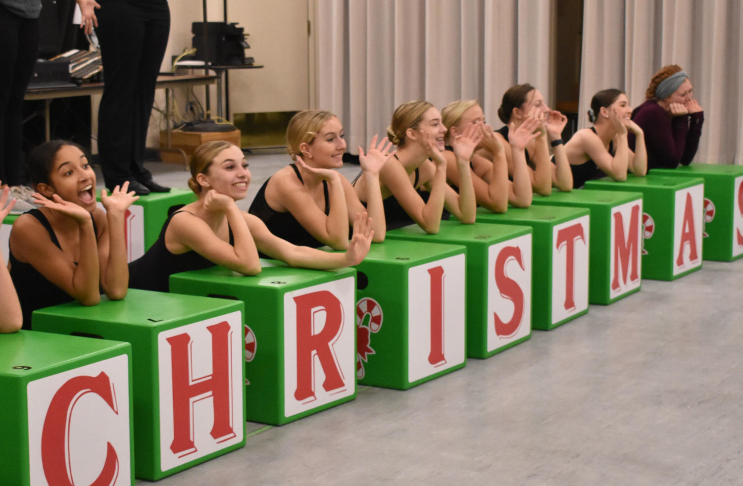 Dancers from Expressenz Dance Center work on their doll number during rehearsal. Dancer and senior Macie Harris (far right)said the letter blocks form words during the dance.
