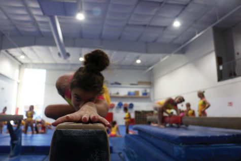 Freshman Ashnaya Gupta practices her beam routine. Gupta said that more gymnasts are speaking out now about sexual abuse after the scandals occurred.