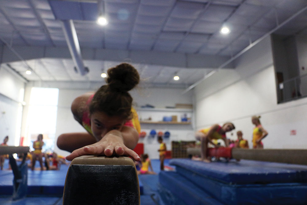 Freshman Ashnaya Gupta practices her bar routine. Gupta said that more gymnasts are speaking out now about sexual abuse after the scandals occurred.