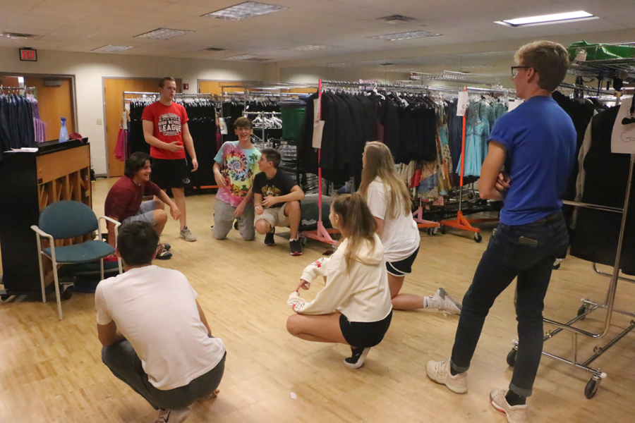 Ayden Stewart (red) and Shawn Horrocks (blue), ComedySportz veteran members and seniors, prepare to lead younger students in an improv game. The goal of the game was to practice rhyming skills.