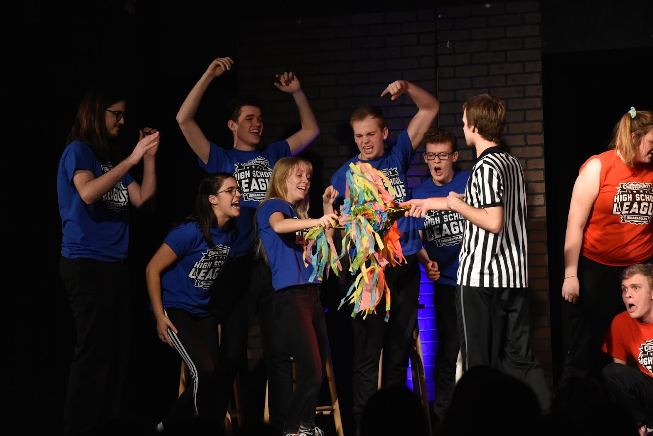 Comedysportz%3A%0AThe+Carmel+Comedysportz+team+celebrates+after+the+announcement+that+they+have+won+their+match+on+Feb+22+in+the+Carmel+High+School+studio+theater.+The+Comedysportz+team+participates+in+competitive+improvisation+games+at+local+high+schools%2C+their+next+home+match+will+be+March+21+and+22+in+the+studio+theater.