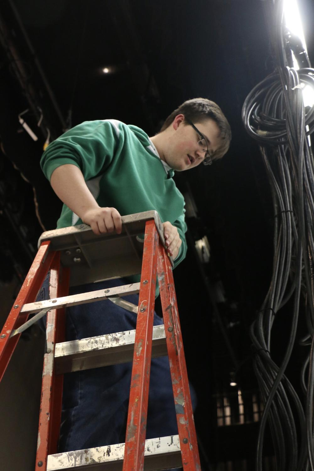 Heightened+Experience%3A%0ATech+theater+student+and+sophomore+Ben+Outland+works+on+cabling+lights+on+March+18+for+upcoming+musical+Bring+It+On+which+runs+May+9-11.+Outland+said%2C+%E2%80%9Ctech+theater+is+a+really+fun+time.+After+school+you+get+to+hang+out+with+some+of+your+friends+and+you+just+get+to+do+cool+stuff%2C+like+hanging+up+lights%2C+wiring+things%2C+building+things%2C+and+all+that+kinda+stuff.%E2%80%9D