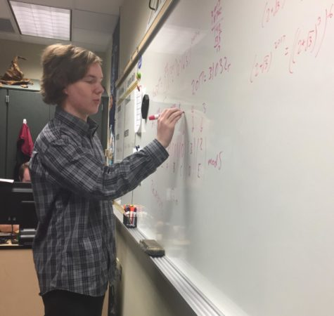 Co-president and senior Joey Heerens explains the problems that Math Club members missed in the Rose Hulman competition. The Rose Hulman competition happened on Nov. 10 at the Rose-Hulman Institute of Technology.