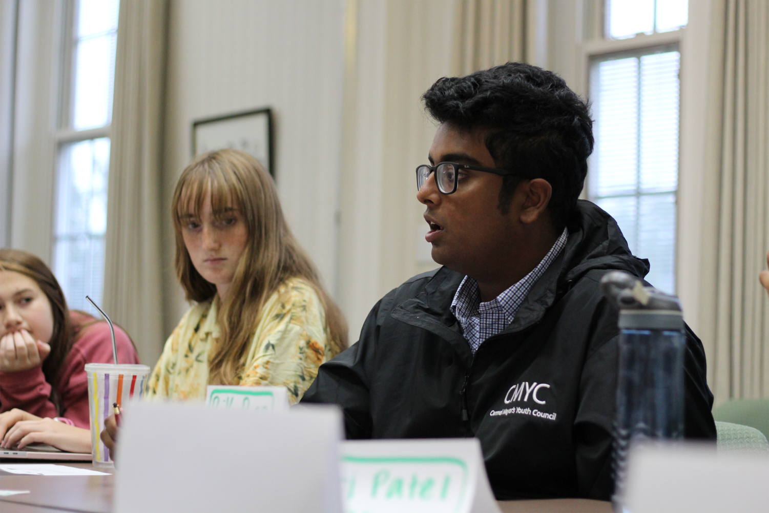 "Rik Bag, Carmel Mayor's Youth Council (CMYC) president and senior, addresses the council members during a meeting. Bag said, ""I think our progression as a council, not just from month to month but also year by year, like term by term—I think we're doing really well."""