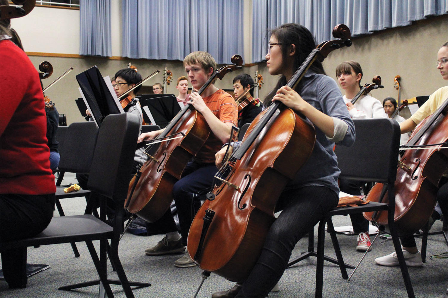 "Selin Oh, Camerata cellist and senior, reh- earses after school. She said one of the pieces they're playing, ""Dvorak Symphony No. 9,"" is really special to her, and she's excited to share it with other musicians."