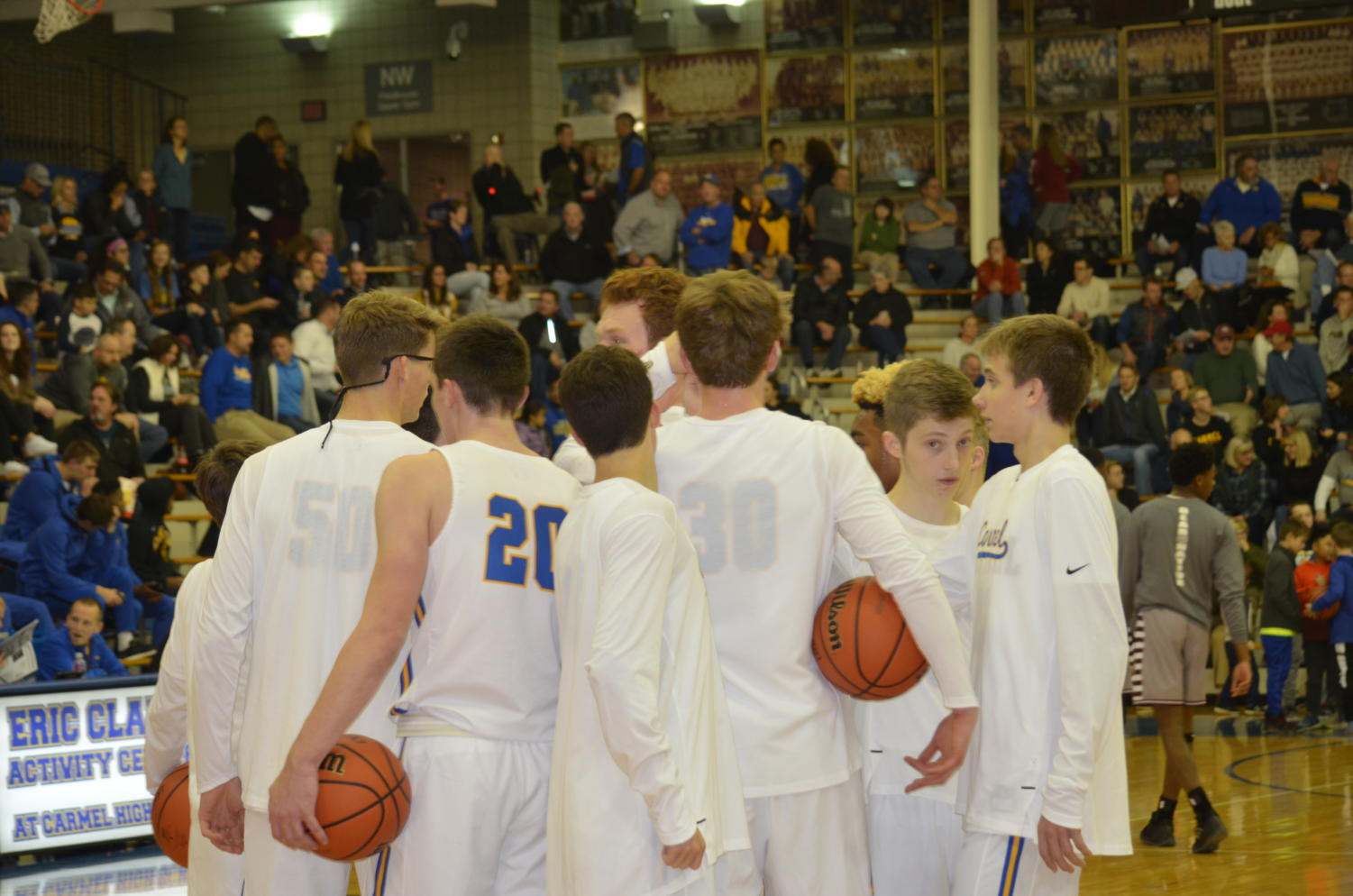 The men's basketball team huddles up before their game against Lawerence Central High School. They face Zionsville Community High School on Dec. 6 at CHS.