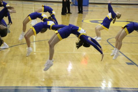 Winter Cheerleading will encourage fans to cheer on the women's basketball team Dec. 7.