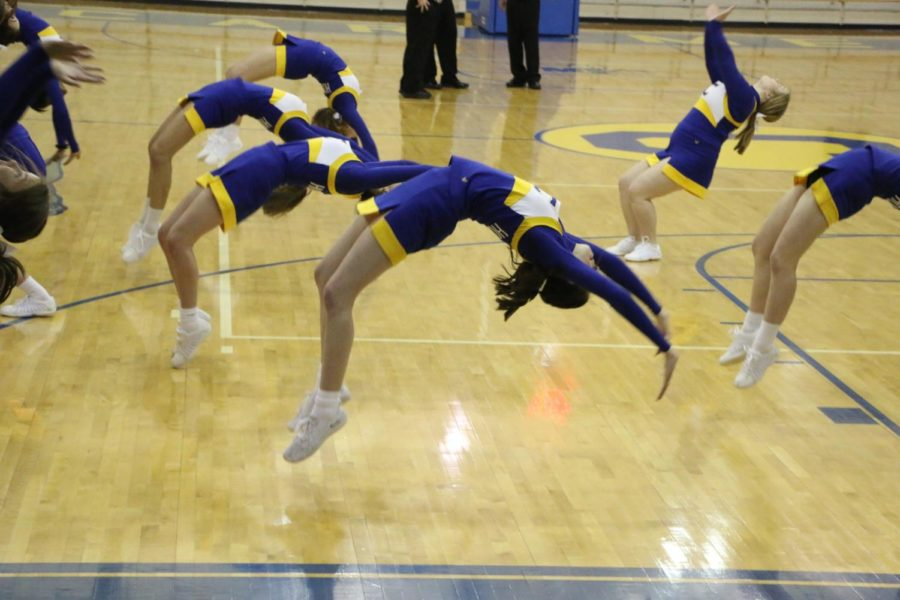 Winter+Cheerleading+team+does+a+back+handspring+during+their+time+out+cheer.+They+were+cheering+at+a+Women%27s+basketball+game+on+Nov.+27.+