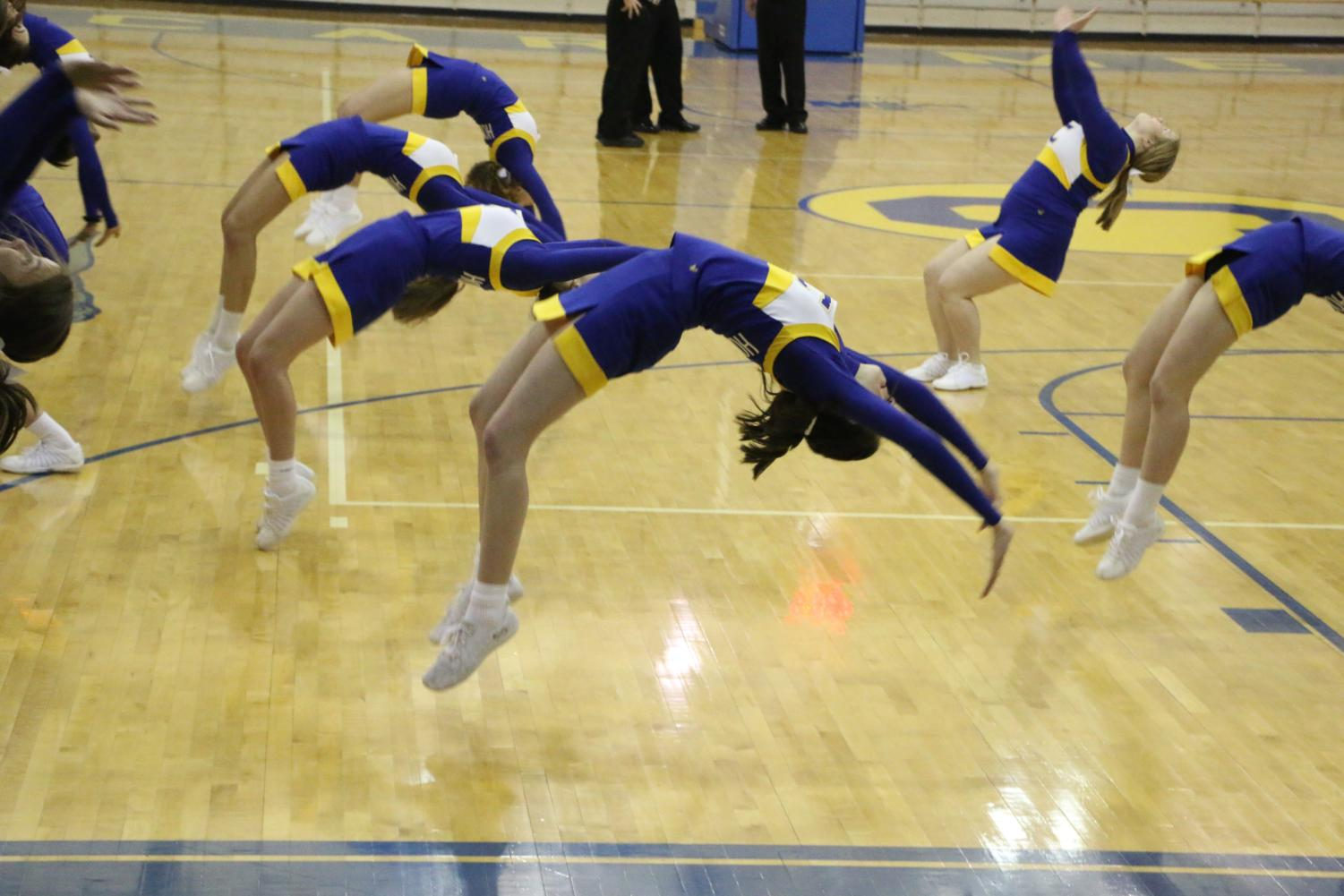 Winter Cheerleading team does a back handspring during their time out cheer. They were cheering at a Women's basketball game on Nov. 27.