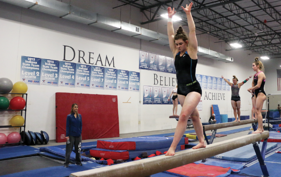 Gymnastic+COMMITMENT%3A%0AGymnast+and+senior+Hadyn+Crossen+practices+her+routine+on+the+bar+with+her+group.%0ACrossen+said+that+her+coaches+helped+her+understand+what+each+college+and+university+had+offered+when+they+had+started+giving+offers+to+her.+She+said+she+ended+up+committing+later+than+most+other+gymnasts+to+keep+her+options+open.