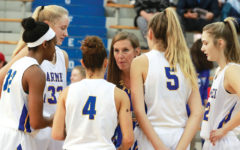 Women's basketball team benefits from strong role model coach