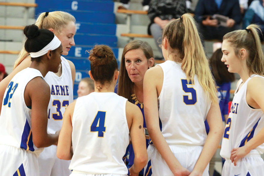 Erin Trimpe, women's basketball head coach, encourages her team before their first game against the Homestead Spartans on Nov. 3. Trimpe said she always wants to see her team be aggressive.