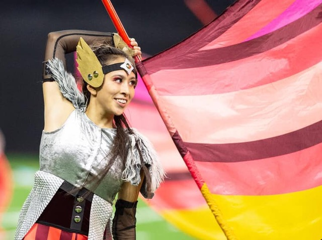 A+guard+member+waves+her+flag+during+the+Bands+of+America+Grand+Nationals+Championship%2C+which+took+place+in+early+November.+Krissy+Sass%2C+guard+member+and+sophomore%2C+said+the+team+will+not+have+any+major+events+or+competitions+until+the+end+of+January.