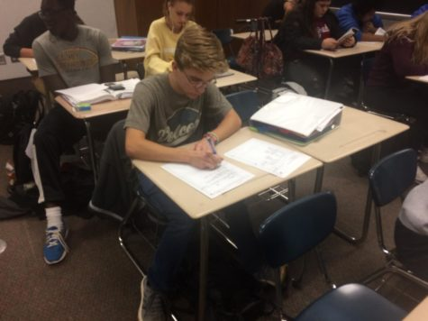 "Junior Cameron Milam works on an assignment for AVID. He said he believes AVID can be very helpful for his future. ""It teaches me how to ask questions, how to answer those questions and how to prepare for college and my future,"" Milam said."