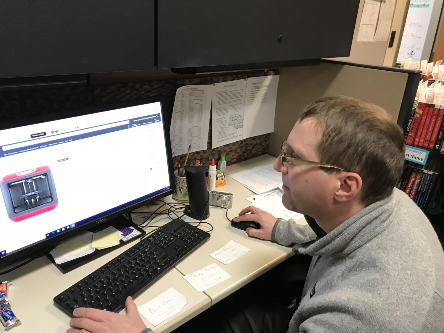 Young adult librarian Michael Cherry works at his desk at the Young Adult Center. The Young Adult Center will be hosting events throughout the year such as Finding your College Fit.