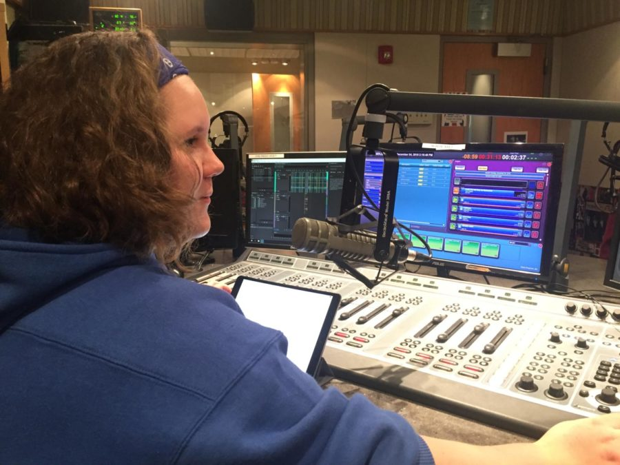 """In the recording booth, Abby Draper, head of the news department and senior, live records her new game segment. Draper has created a new a show called """"The Band Stand"""" and said she is excited for listeners to hear the new content."""