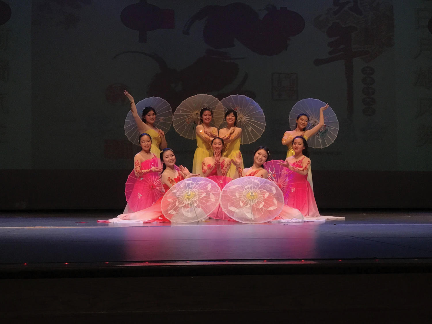 Get Cultured: Junior Hannah Liu (far right, second row) performs a traditional dance. Liu said reproducing shows is a good way to give exposure to the original show.