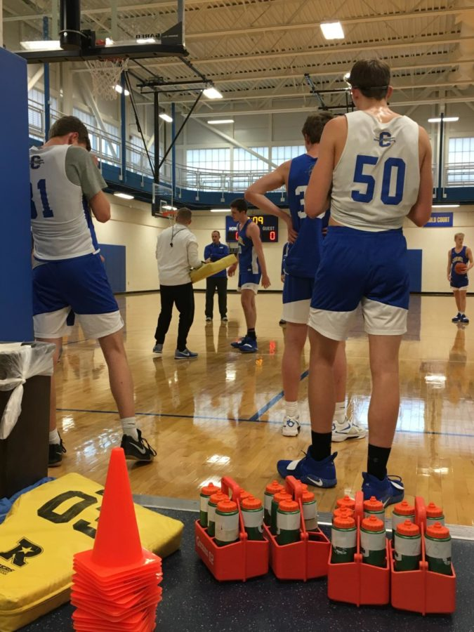 The CHS men's basketball team practices in the Blue and Gold gym for their tough regular season schedule. The rigor of opponents helps prepare the hounds for the more meaningful games down the road in the postseason, according to Osborn.