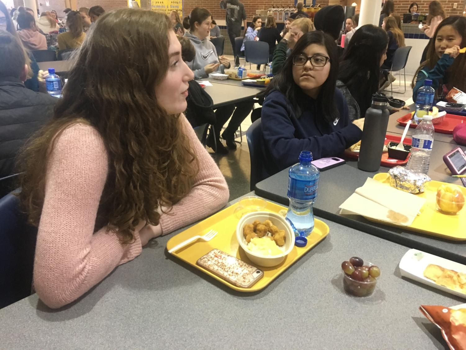 Sarah Konrad, TEDx member and sophomore, talks to her friends while eating lunch in Greyhound Station. She said she is sad that social studies teacher Allison Hargrove is no longer the TEDx sponsor, as she always talked to all the club members and had a positive effect on the club.