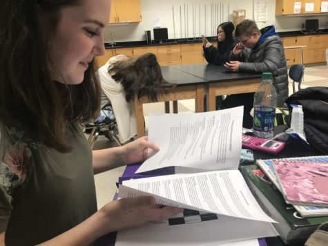 Lindsay Vrobel, Rhapsody member and sophomore, reviews the choir audition schedule during SRT on Jan. 10. Vrobel auditioned for New Edition.