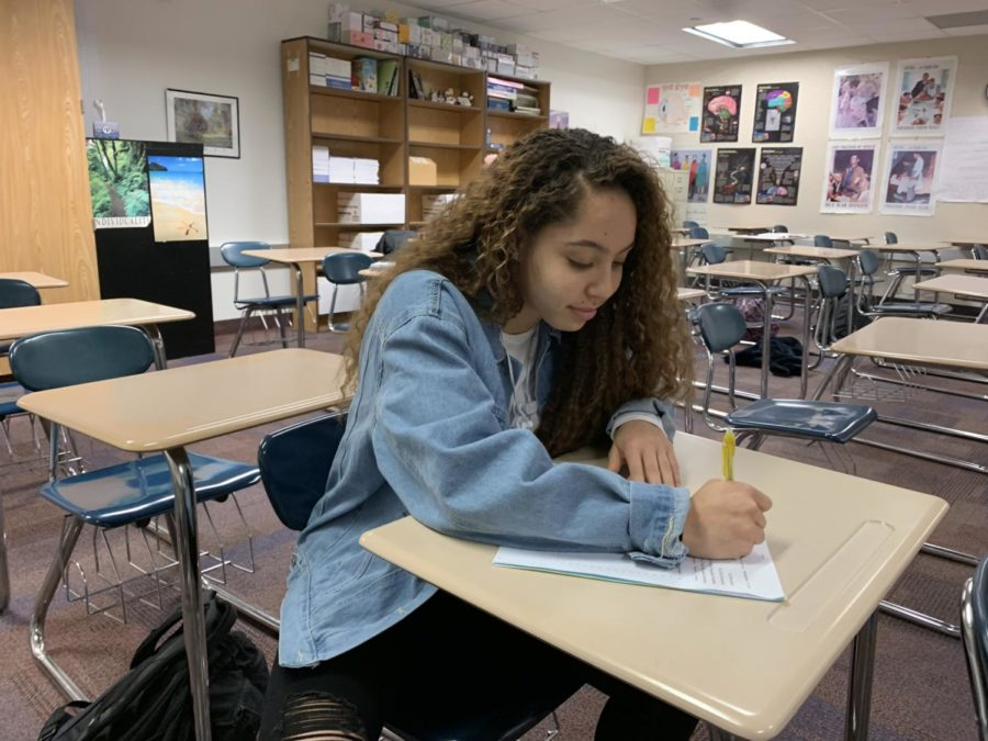 Mentor and junior Kiara Gill studies during SRT. She said she is still meeting with her students every gold day and looks forward to being a mentor her senior year as well.