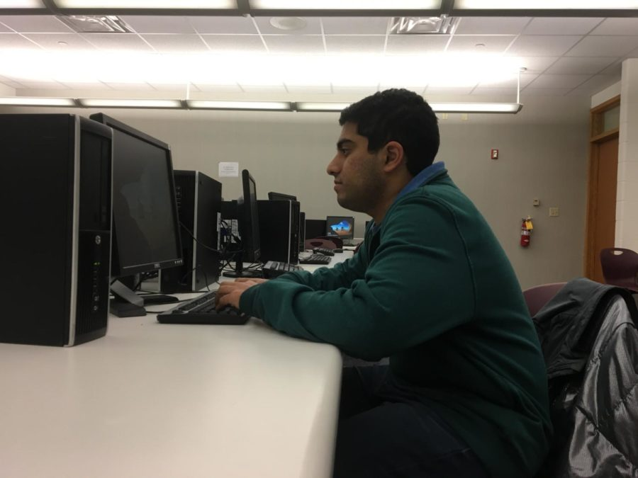 Junior Karthik Arcot works on a computer at the Design for CHS meeting. Design for CHS has scheduled the Street Store for March 16.