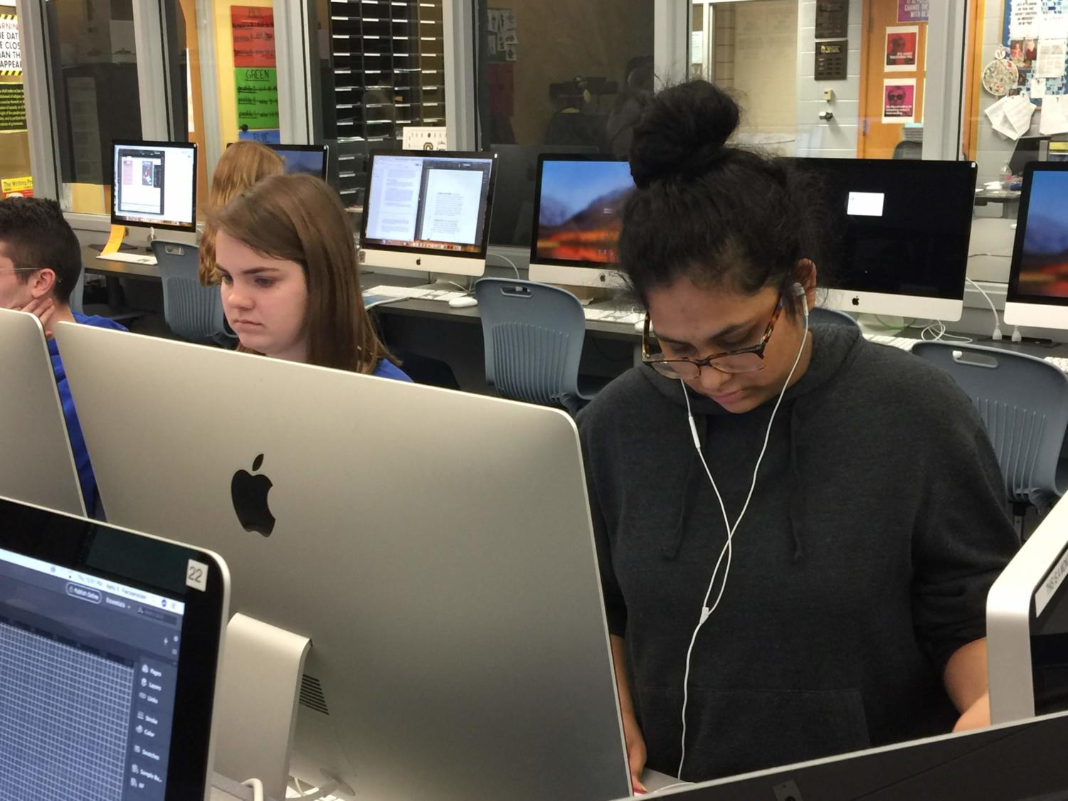 "Sandiya Sajan, Pinnacle Yearbook photo editor and junior, works alongside her fellow staff members to finalize their spreads and edits. ""I'm not as stressed as you may think, I will just keep on working,"" Sajan said."