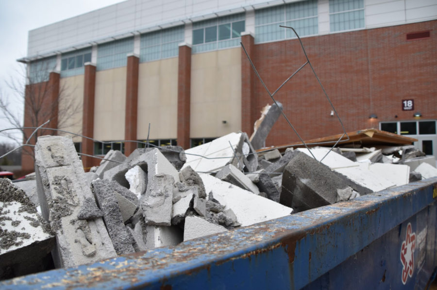 Workers piled debris from the explosion in dumpsters while working at CHS on Jan. 2. According to Principal Tom Harmas, work crews have made efficient progress on repairs to the building but he does not know when all of the damage will be completely fixed. Photographer: Nick Beckman
