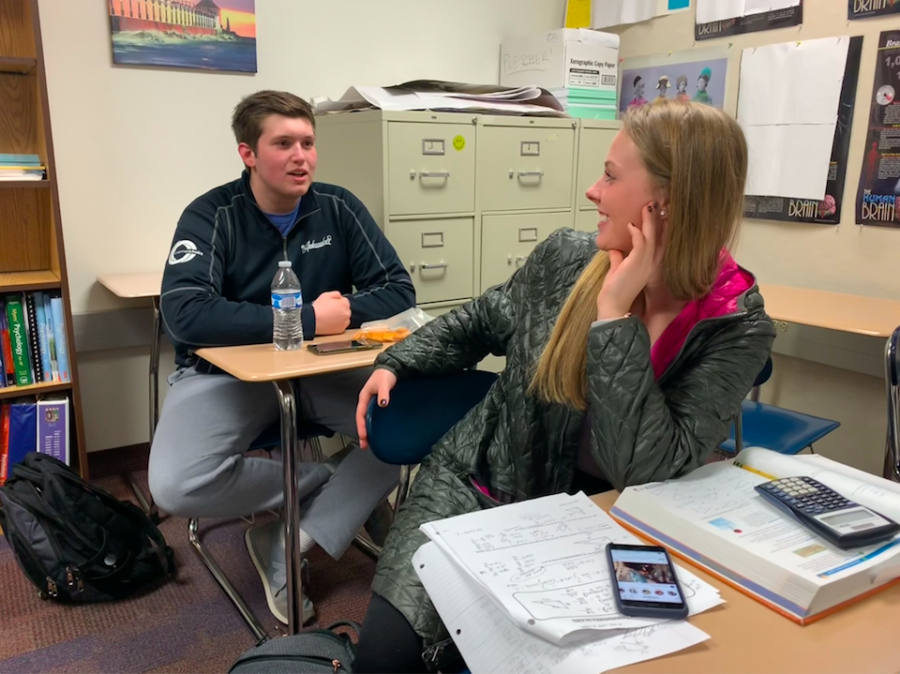 Mentor and senior Cameron Clark talks to a friend during SRT. According to Robin Pletcher, K-8 Mentoring and AP Psychology teacher, most of the mentees are excited to reunite with their mentors after the long winter break.