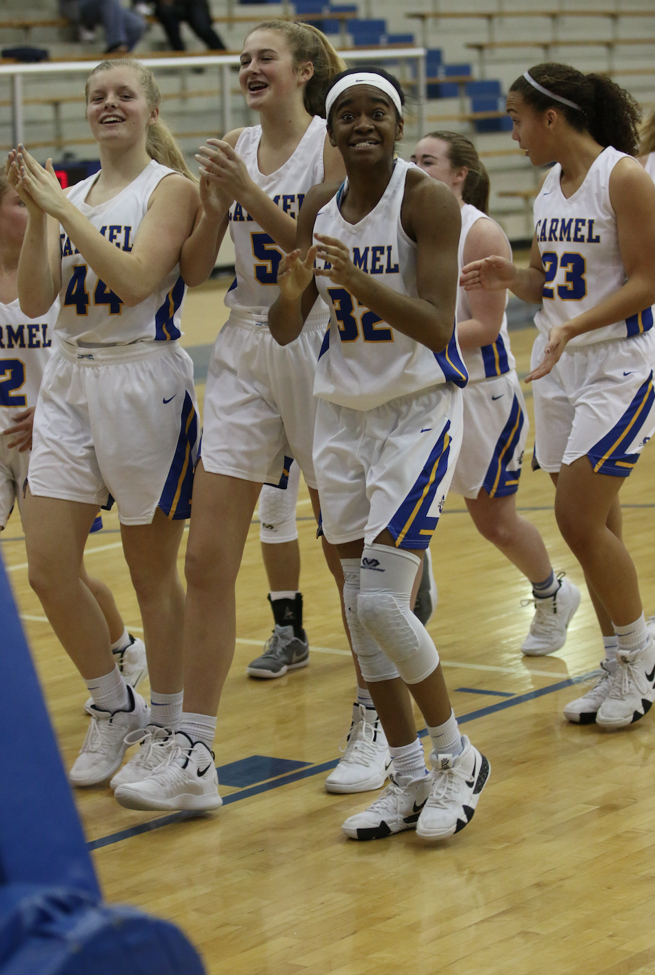 Greyhounds forward and senior Reagan Hune celebrates with her team after a win. Hune is averaging 11.5 points per game.