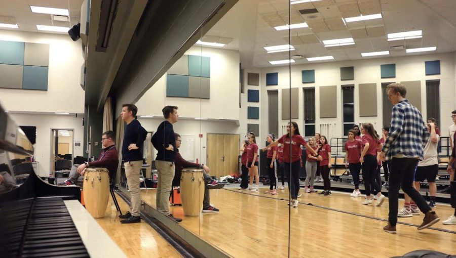 Choir director Kyle Barker oversees the Ambassadors during their rehearsal after school. According to Ambassador and junior Danny Ghalayini, the Half Notes event is a much more interactive experience for the kids than typical choir concerts and events.
