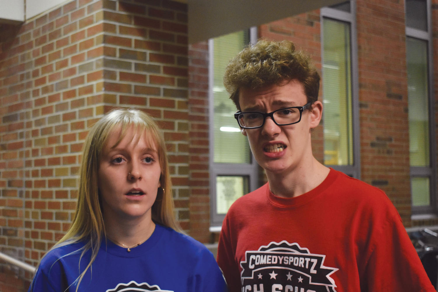 Piper Dafforn, Comedy Sportz team captain and senior, and Comedy Sportz member and senior Austin Roberts make silly faces during an improv game. Both Dafforn and Roberts said Comedy Sportz has benefitted them in many ways.