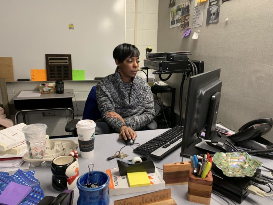 """Speech team sponsor Jacleen Joiner works on her computer. Joiner said she is looking forward to the upcoming competitions this semester. """"(I am most excited for) District, State and Sectional competitions to see how students have improved throughout the year,"""" she said."""