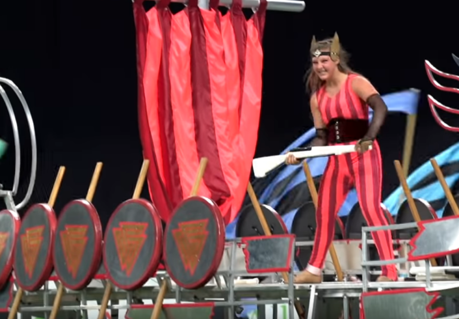 A+guard+member+laughs+as+she+catches+her+rifle+while+performing+at+the+Bands+of+America+%28BOA%29+Grand+National+Championships.+As+the+color+guard+transitions+into+its+winter+season%2C+its+first+performance+for+the+public+will+take+place+Feb.+1+in+the+varsity+gymnasium.+Guard+director+Rosie+Queen+says+the+guard+has+been+rehearsing+since+winter+break.