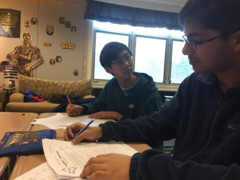 Math Club members review past tests to prepare for competition
