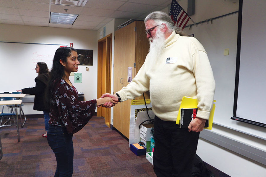 Nakshatri shakes the hand of a guest speaker who came to the CHS Democrats club. Sapna said the club will sometimes host speakers to talk about their specialities or their expertise.