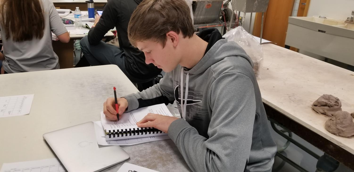 Thomas Gastineau, student leader of CRU Club and senior, works quietly during SRT. Student leaders were assigned themes for each month.