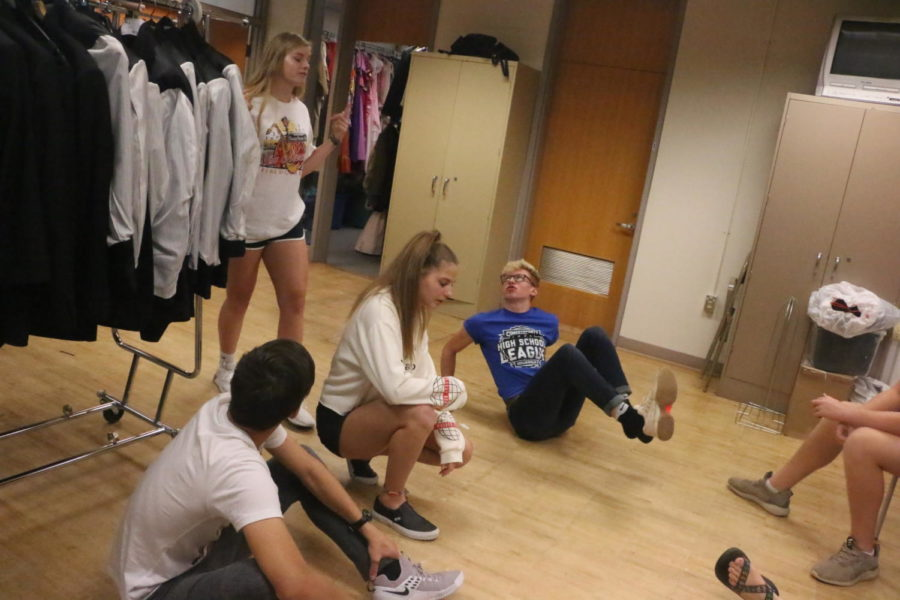 ComedySportz members prepare to play an improv game. This game focused on musical improvisation.