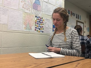 Anne Schuh, Best Buddies president and senior, fills in dates in her planner during SRT. Schuh said Best Buddies will attend Mr. Carmel put on by CHS Champions Together in order to support Best Buddies members in the event as well as CHS  Champions Together.