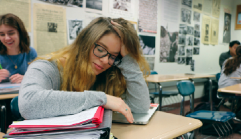 Falling Asleep: Senior Hannah Kosc zones out during SRT. She said she often finds herself extremely tired after long nights staying up in an attempt to complete her homework.