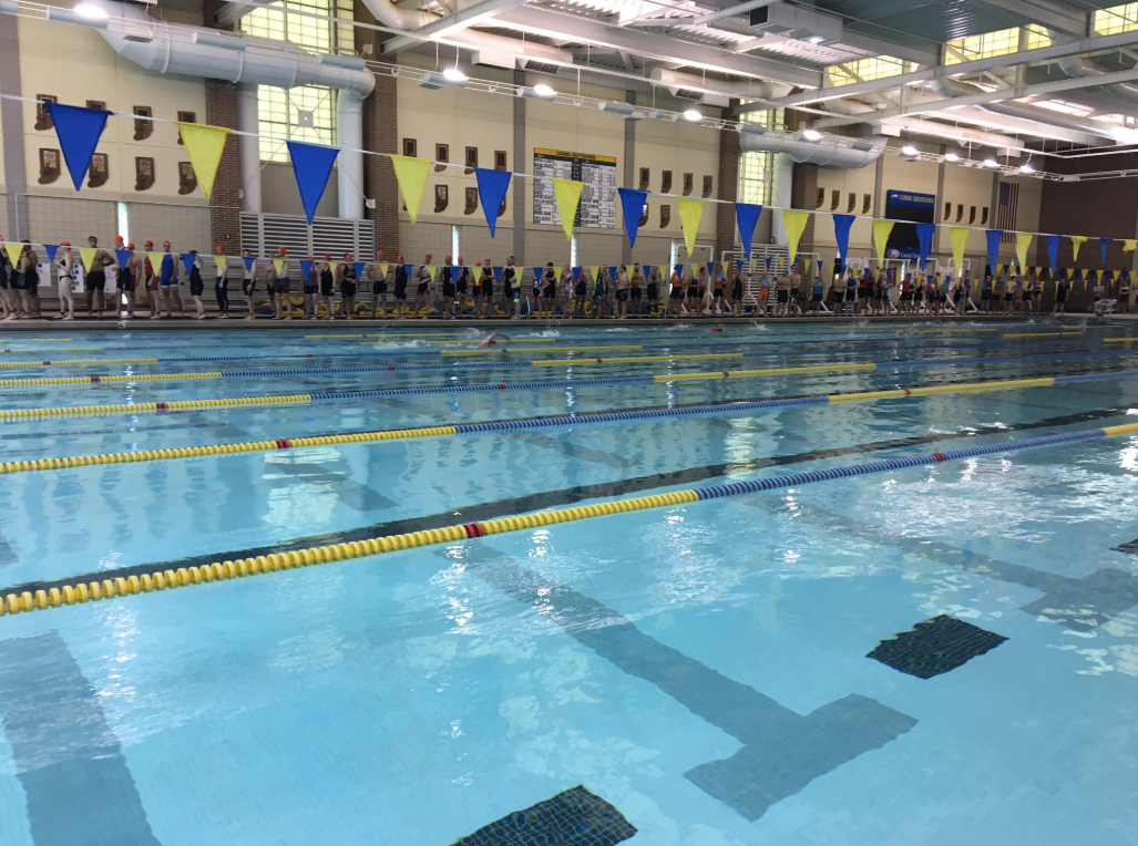 "Both swimming teams warm-up before an afternoon practice. ""The team is excited to compete in the postseason and in the state championship,"" Busha said."