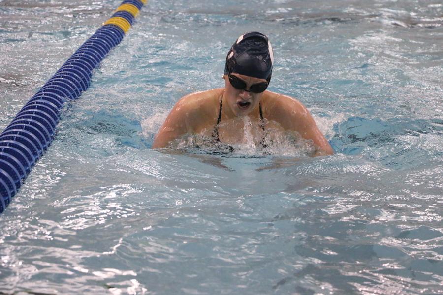PRACTICING FOR THE RACE: Lauren Busha, senior and varsity women's swimmer, swims breaststroke during a team practice. Busha swims the 100-meter breaststroke for the CHS women's swimming team.