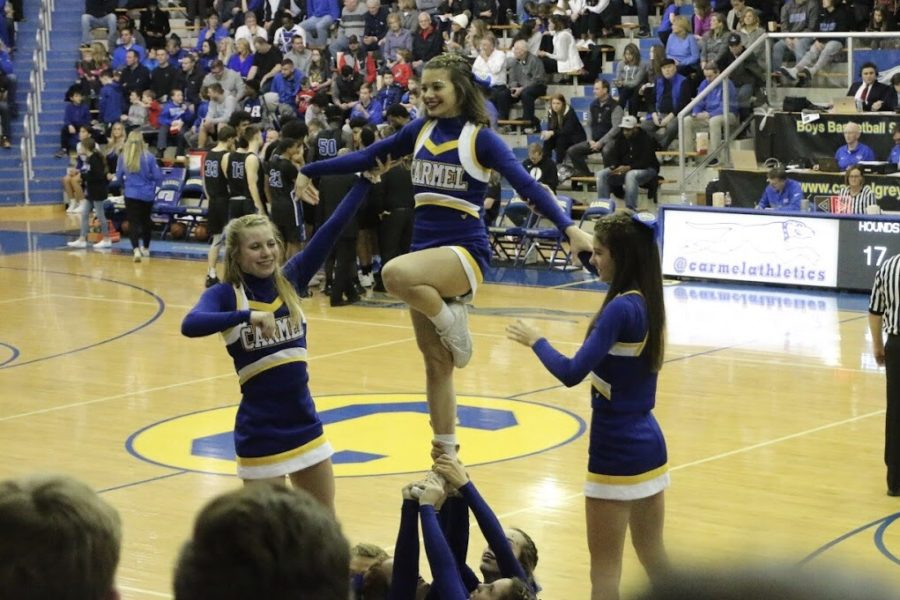 Winter cheerleading holds a pose on Feb. 8. The team cheered on the mens basketball team as they won against Hamilton South Eastern.