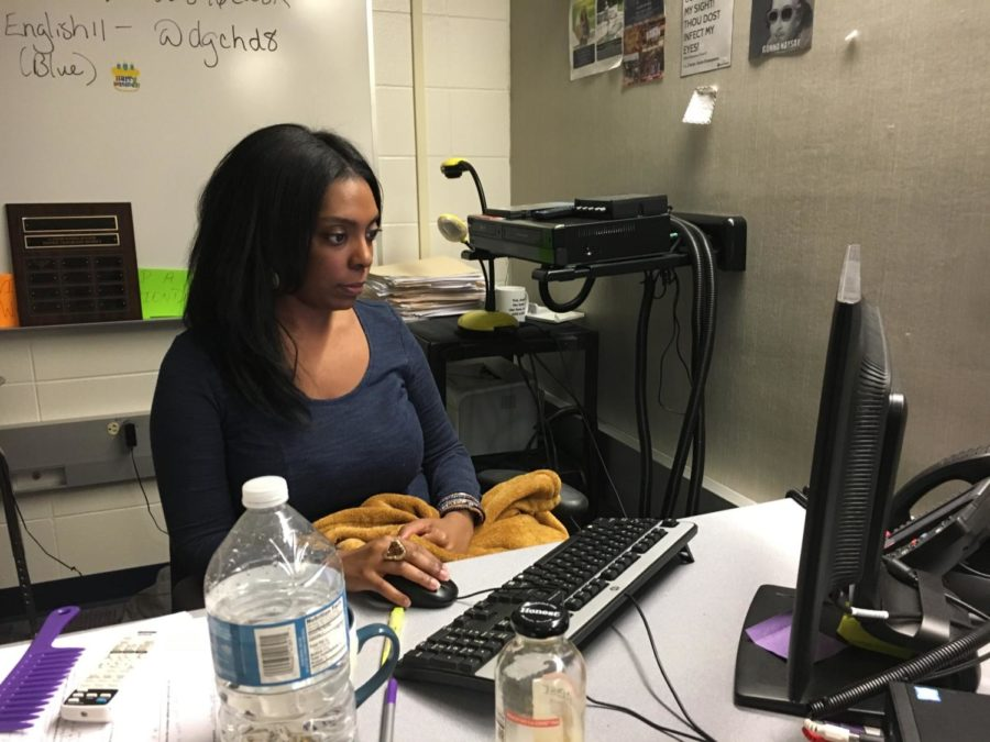 """Speech team sponsor Jacleen Joiner works at her desk. Joiner said she loves leading the speech team members and is most excited to see how they progress. """"I enjoy seeing the improvement and confidence that students gain over the course of the year,"""" she said."""